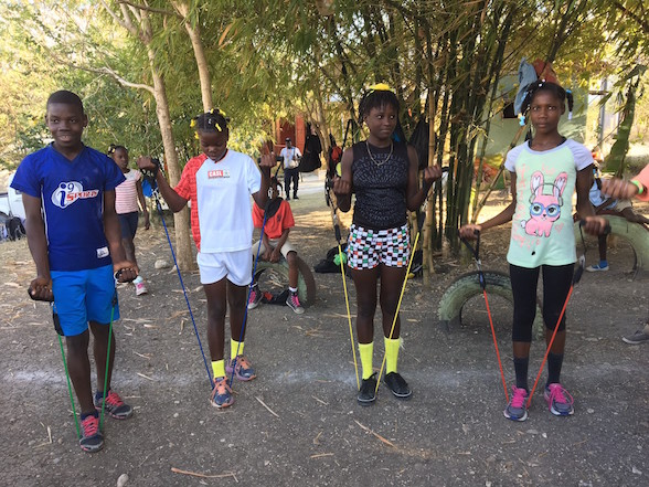 Jean Tassy, Bynia, Kattie and Mada use the resistance bands for the first time.